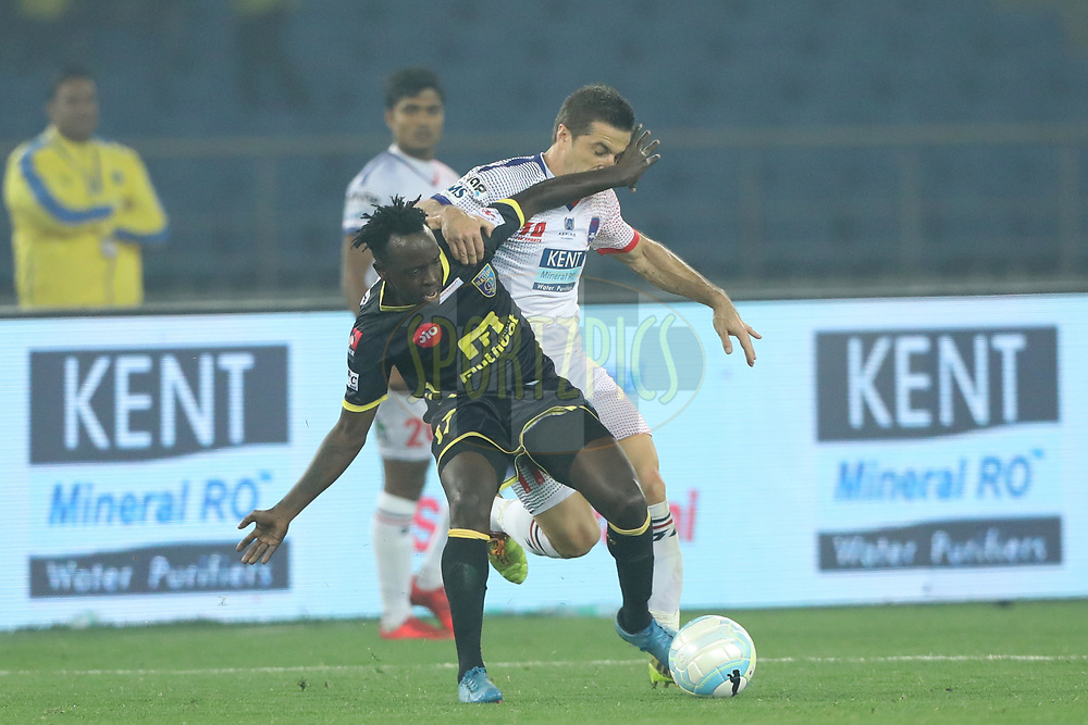 Eduardo Moya Cantillo of Delhi Dynamos FC and keziron Kizito of Kerala Blasters FC during match 43 of the Hero Indian Super League between Delhi Dynamos FC and Kerala Blasters FC  held at the Jawaharlal Nehru Stadium, Delhi, India on the 10th January 2018<br /> <br /> Photo by: Arjun Singh  / ISL / SPORTZPICS