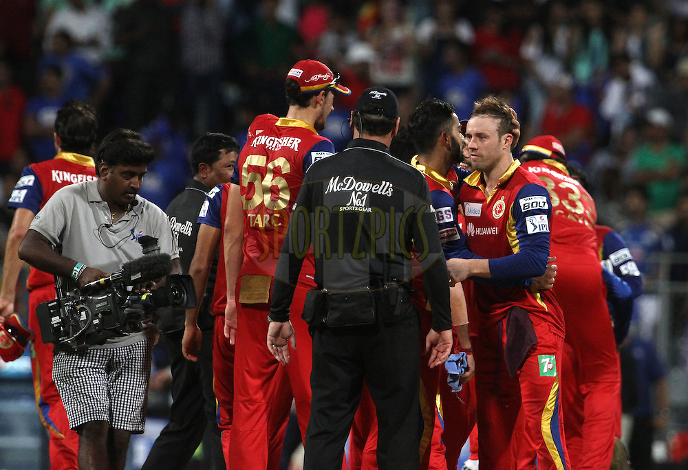 Royal Challengers Bangalore players shake hands after winning the match 46 of the Pepsi IPL 2015 (Indian Premier League) between The Mumbai Indians and The Royal Challengers Bangalore held at the Wankhede Stadium in Mumbai, India on the 10th May 2015.<br /> <br /> Photo by:  Vipin Pawar / SPORTZPICS / IPL