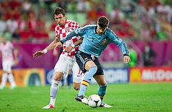 Mario Mandzukic of Croatia vs Gerard Pique of Spain during the UEFA EURO 2012 group C match between  Croatia and Spain at PGE Arena Gdansk on June 18, 2012 in Gdansk / Danzig, Poland. (Photo by Vid Ponikvar / Sportida.com)