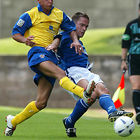 St Johnstone v Queen of the South....09.08.03<br />Paul Bernard battles with Derek Lyle<br /><br />Picture by Graeme Hart.<br />Copyright Perthshire Picture Agency<br />Tel: 01738 623350  Mobile: 07990 594431
