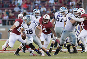 PALO ALTO, CA - SEPTEMBER 2:  Jesse Ertz #16 of the Kansas State Wildcats scrambles under pressure from Peter Kalambayi #34 of the Stanford Cardinal during an NCAA football game played on September 2, 2016 at Stanford Stadium on the campus of Stanford University in Palo Alto, California.  At right is Solomon Thomas #90 of Stanford.  (Photo by David Madison/Getty Images)