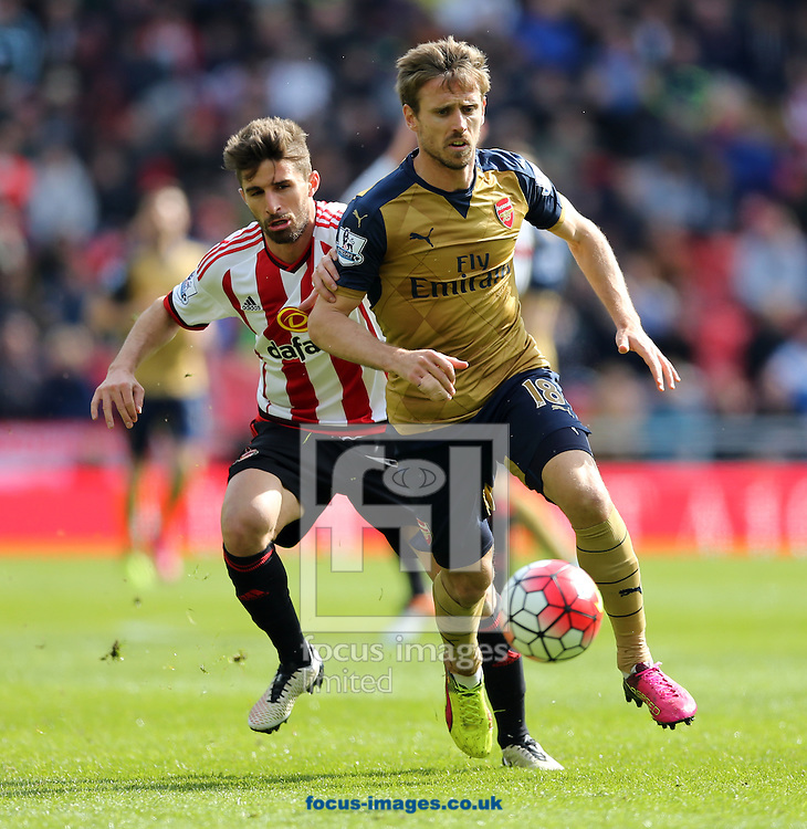 Fabio Borini (l) of Sunderland and Nacho Monreal of Arsenal during the Barclays Premier League match at the Stadium Of Light, Sunderland<br /> Picture by Simon Moore/Focus Images Ltd 07807 671782<br /> 24/04/2016