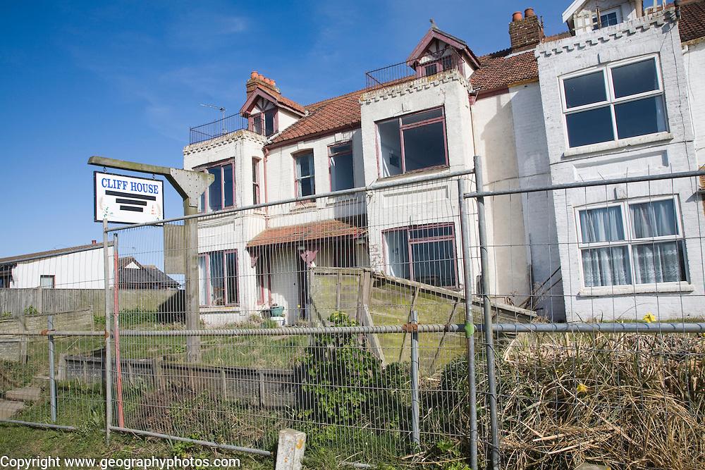 Houses abandoned and derelict awaiting demolition because of coastal erosion, Happisburgh, Norfolk, England