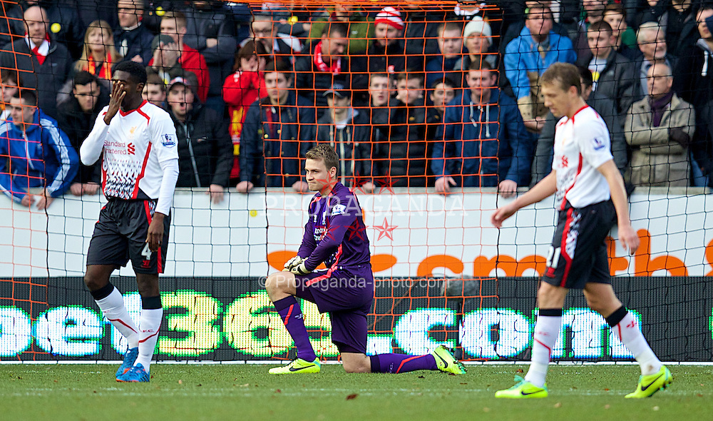 HULL, ENGLAND - Sunday, December 1, 2013: Liverpool's goalkeeper Simon Mignolet looks dejected as Hull City score the opening goal during the Premiership match at the KC Stadium. (Pic by David Rawcliffe/Propaganda)