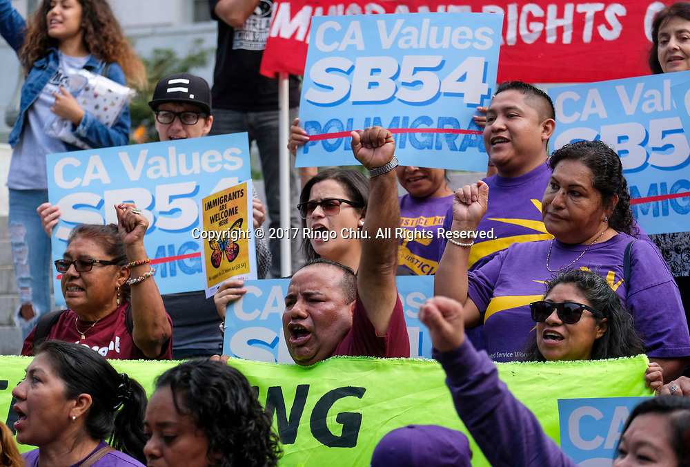 A group from various advocate organizations  protest in Los Angeles, the United States, on September 14, 2017, to call on the state Assembly to pass SB 54, the so-called sanctuary state legislation. The bill would protect communities from President Donald Trump's ``mass deportation agenda'' and prevent state resources being used to separate families. &quot;My grandparent came here freely, that's what this country should be about.&quot; A protester, Sam Samalin said,  (Xinhua/Zhao Hanrong)(Photo by Ringo Chiu)<br /> <br /> Usage Notes: This content is intended for editorial use only. For other uses, additional clearances may be required.
