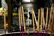incense sticks burning at Buddhist temple