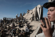 Libya, Sirte: Fighters of the Libyan forces affiliated to the Tripoli government are seen on the frontline with ISIS in Al Jiza neighbourhood on November 26, 2016.  Alessio Romenzi