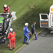 NASCAR Sprint Cup driver Denny Hamlin (11) climbs from his car after a wreck during the NASCAR Coke Zero 400 Sprint series auto race at the Daytona International Speedway on Saturday, July 6, 2013 in Daytona Beach, Florida.  (AP Photo/Alex Menendez)