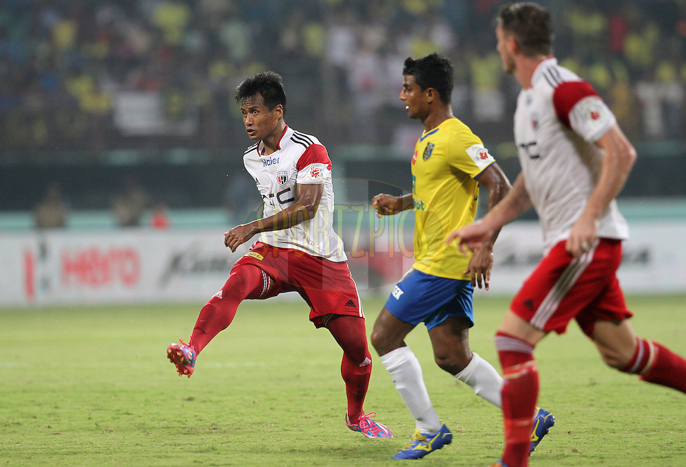 Durga Boro of NorthEast United FC on the attack during match 49 of the Hero Indian Super League between Kerala Blasters FC and North East United FC held at the Jawaharlal Nehru Stadium, Kochi, India on the 4th December 2014.<br /> <br /> Photo by:  Vipin Pawar/ ISL/ SPORTZPICS