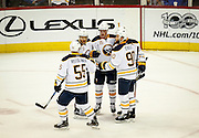 SHOT 2/25/17 8:45:36 PM - Buffalo Sabres teammates celebrate a goal by linemate Sam Reinhart #23 against the Colorado Avalanche during their NHL regular season game at the Pepsi Center in Denver, Co. The Avalanche won the game 5-3. (Photo by Marc Piscotty / © 2017)