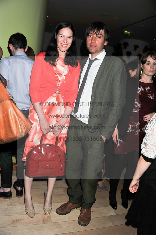 ALEX JAMES and his wife CLAIRE at an after party following the first night of Dr Dee: An English Opera,  an opera created by theatre director Rufus Norris and musician and composer Damon Albarn held at St.Martin's Lane Hotel, St.Martin's Lane, London on 25th June 2012.