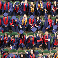 Nettleton graduates throw their mortarboards into the air after they completed their graduation ceremony at BancorpSout Arena Saturday morning.