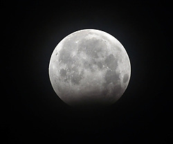August 8, 2017 - Kolkata, West Bengal, India - A partial lunar eclipse is observed  in Kolkata, India on Monday , 7th August , 2017 night from all across the country. The partial lunar eclipse also visible from most parts of South and East Asia, Europe, Africa and Australia. (Credit Image: © Sonali Pal Chaudhury/NurPhoto via ZUMA Press)