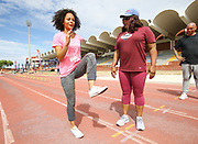 Mar 10, 2018; Cape town, South Africa; Coach Sharrieffa Barksdale of the USA (1984 Los Angeles Olympic Games 400m hurdles gold medal winner) showing Traci-lee Hendricks of Portlands High School some drills during the TrackGirlz events at University of Western Cape on March 10, 2018 in Cape Town, South Africa. (Roger Sedres/Image of Sport)