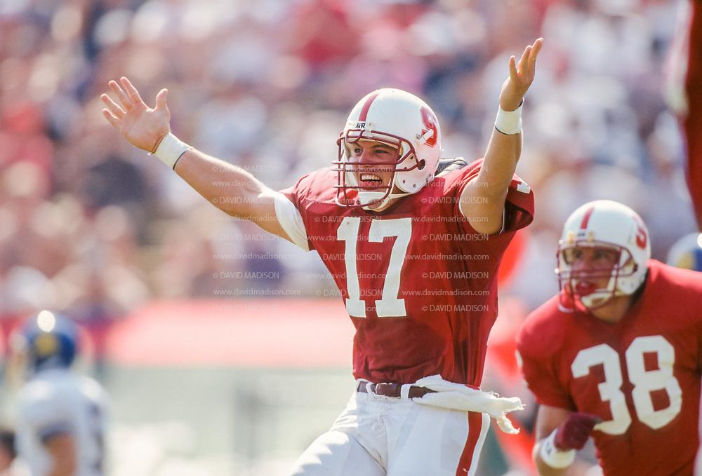 COLLEGE FOOTBALL: Stanford vs SJS played on September 26, 1992 at Stanford Stadium in Palo Alto, California.  John Lynch #17 SU celebrates.