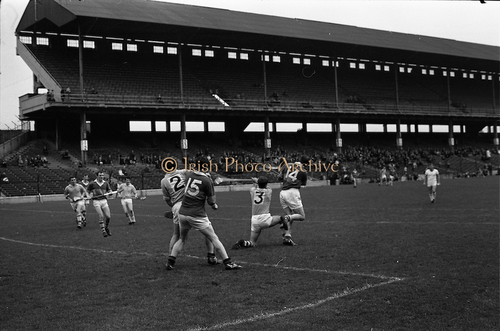 05/10/1969<br /> 10/05/1969<br /> 5 October 1969<br /> All-Ireland Junior (Home) Final: Kerry v Antrim at Croke Park, Dublin. <br /> Kerry full-forward, W. McCarthy (14), searches for the ball as it sails past Antrim full-backs, J. Mulhalland (2) and N. McMullan. Kerry full-forward, J. Gannan (center-right), waits to see what will happen.