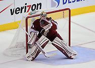 May 13, 2012; Glendale, AZ, USA; Phoenix Coyotes goalie Mike Smith (41) catches the puck in the second period of game one of the Western Conference finals of the 2012 Stanley Cup Playoffs at Jobing.com Arena.  The Kings defeated the Coyotes 4-2.  Mandatory Credit: Jennifer Stewart-US PRESSWIRE.