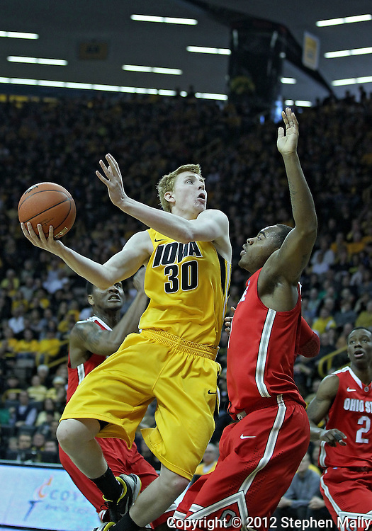 January 07, 2011: Iowa Hawkeyes forward Aaron White (30) tries to put up a shot as Ohio State Buckeyes forward Deshaun Thomas (1) defends during the the NCAA basketball game between the Ohio State Buckeyes and the Iowa Hawkeyes at Carver-Hawkeye Arena in Iowa City, Iowa on Saturday, January 7, 2012.