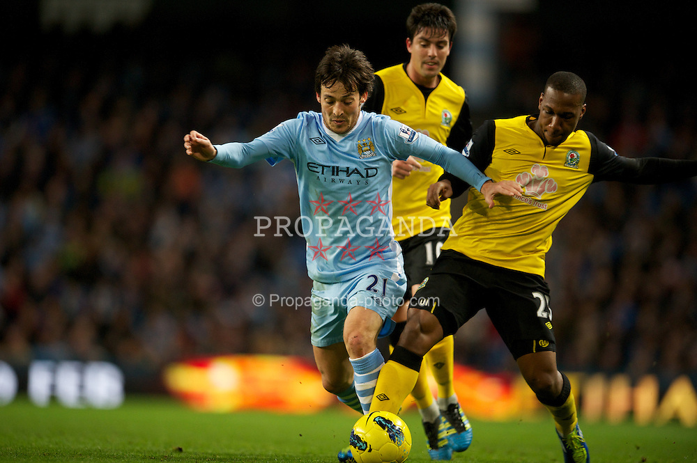 MANCHESTER, ENGLAND - Saturday, February 25, 2012: Manchester City's David Silva in action against Blackburn Rovers' David Hoilett during the Premiership match at City of Manchester Stadium. (Pic by David Rawcliffe/Propaganda)