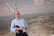 Writer Alain de Botton stands by a mural of a launching Roskosmos Soyuz rocket while researching his book, The Pleasures and Sorrows of Work (Hamish Hamilton, UK 2009) at ESA's Kourou Spaceport