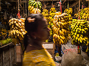 10 NOVEMBER 2014 - SITTWE, MYANMAR: A woman walks through the banana market in Sittwe, Myanmar. Sittwe is a small town in the Myanmar state of Rakhine, on the Bay of Bengal.    PHOTO BY JACK KURTZ
