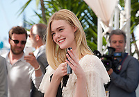 Actress Elle Fanning photographing the press photographers at the The Neon Demon film photo call at the 69th Cannes Film Festival Friday 20th May 2016, Cannes, France. Photography: Doreen Kennedy