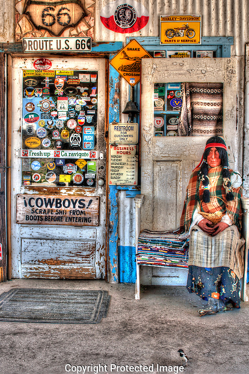 This HDR photograph of the front door at the Hackberry Store reveals colorful memorabilia from the era of Route 66 and the Mother Road.