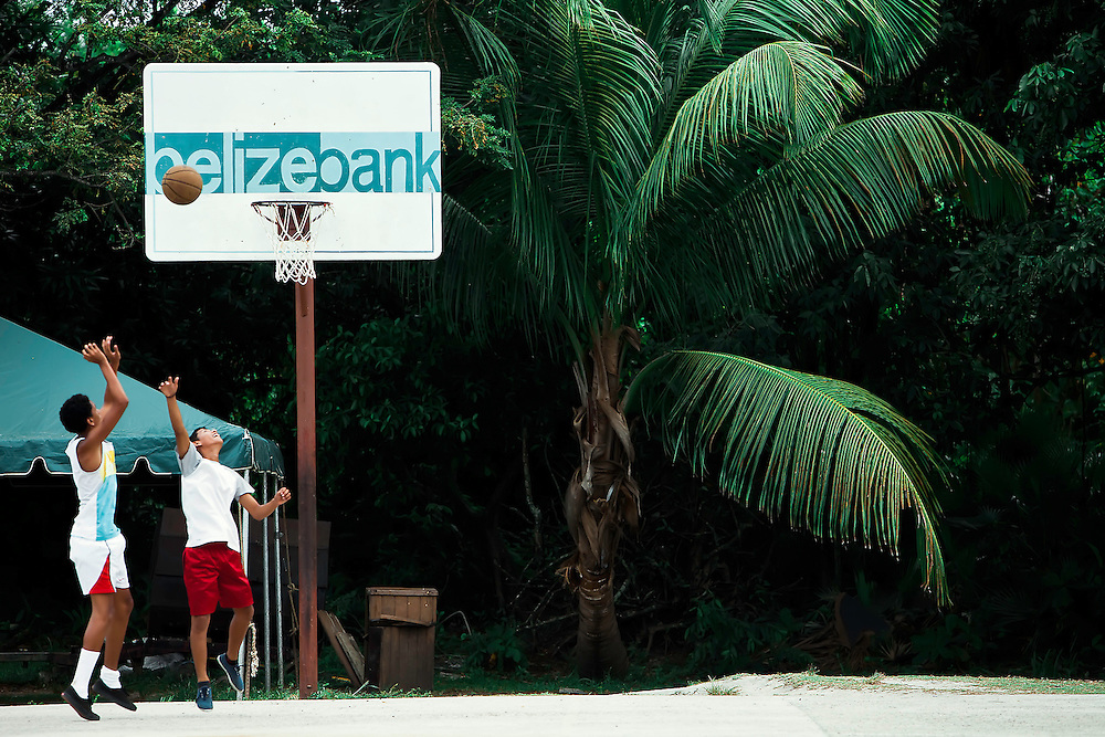 Boys play basketball in Placencia, Belize. Copyright 2014 Reid McNally.