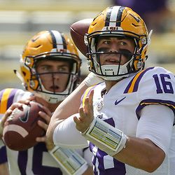 Oct 14, 2017; Baton Rouge, LA, USA; LSU Tigers quarterback Danny Etling (16) and quarterback Myles Brennan (15) warm up before a game against the Auburn Tigers at Tiger Stadium. Mandatory Credit: Derick E. Hingle-USA TODAY Sports