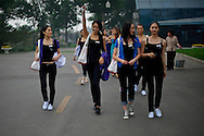 Contestants for the Miss Universe China Pageant make their way throuhg a training camp for contestants in Beijing, China on Thursday, June 23, 2011.   The training camp was created by cosmetics businesswoman and Chinese-American television personality Yue-Sai Kan's to give China, which has never won a Ms. Universe Contest, a cpotential contender in the upcoming beauty pagent.
