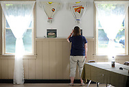 Lynn Hand, of Quakertown, Pennsylvania looks at some of the memorabilia on display during Ockanickon Scout Reservation's 75th anniversary celebration Saturday, June 18, 2016 in Pipersville, Pennsylvania.   (Photo by William Thomas Cain)