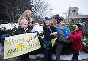 Omaha Skutt Catholic High School student Kelli Zavadil hugs Jack Lenz after arriving at St. Gerald Catholic Church on Monday, Jan. 25, 2016, in Ralston. Jack along with his brother Luke and mother Nancy were waiting to welcome home his sister Abbey and father Tom. Students and chaperones from the Omaha Archdiocese arrived home after being stranded in a snow storm about two hours from Pittsburgh on Friday evening while returning from the March for Life in Washington, D.C.