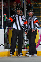 KELOWNA, CANADA - JANUARY 7: Referees Chris Crich and Kevin Webinger stand at the penalty box during a time out at the Kelowna Rockets against the Kamloops Blazers on January 7, 2017 at Prospera Place in Kelowna, British Columbia, Canada.  (Photo by Marissa Baecker/Shoot the Breeze)  *** Local Caption ***