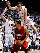 BYU guard Jackson Emery, top, falls on New Mexico forward Drew Gordon, bottom, as he and forward Noah Hartsock (34) defends during the second half of an NCAA college basketball game in Provo, Utah, Wednesday, March. 2, 2011. New Mexico defeated third-ranked BYU 82-64. (AP Photo/Colin E Braley)