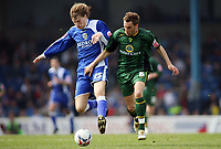 Glenn Loovens for Cardiff City fends off the challenge of Norwich Citys Darren Huckerby