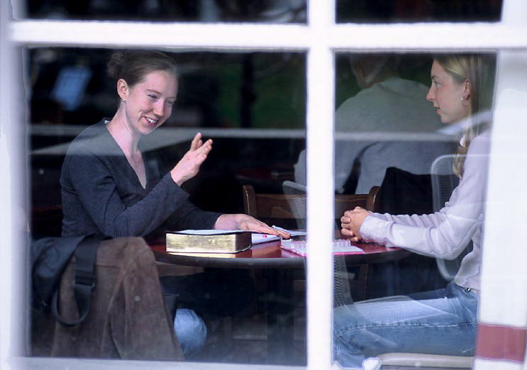 Left, Lisa Freeman of Campus Crusade for Christ in Athens, talks with Laura Chapman, a unior from Dover, Ohio, in the Front Room Campus Coffeehouse during their weekly Bible study..Hanson Photo