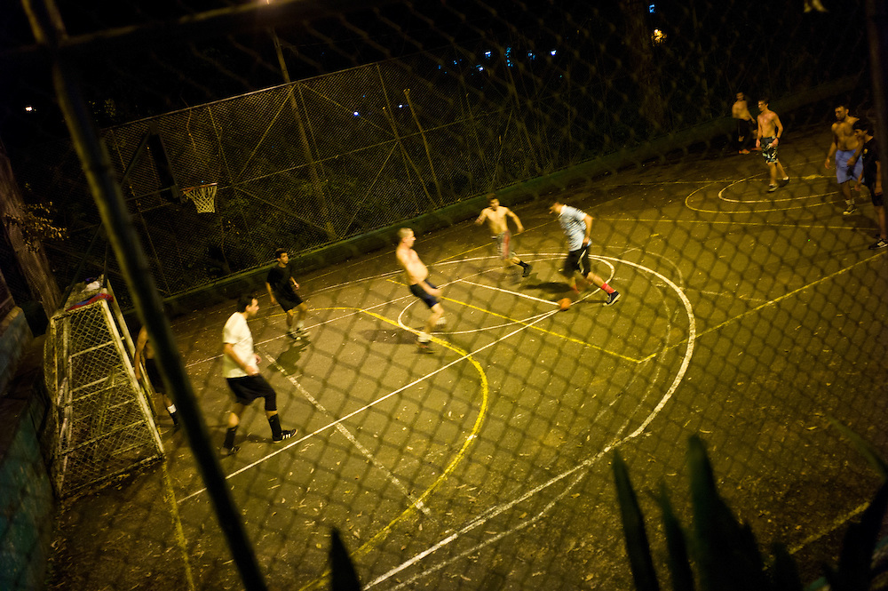 Playing soccer at night in Medellín, Antioquia, Colombia.