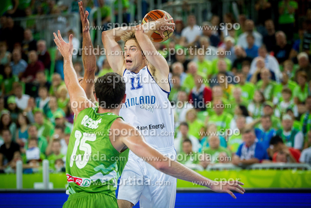 Mirza Begic of Slovenia vs Petteri Koponen #11 of Finland during basketball match between National teams of Slovenia and Finland in Round 2 at Day 13 of Eurobasket 2013 on September 16, 2013 in Arena Stozice, Ljubljana, Slovenia. (Photo by Vid Ponikvar / Sportida.com)