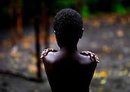 Vanuatu, Tafea Province, Tanna Island, boy feeling cold
