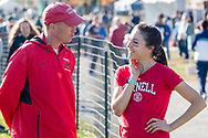 New York, New York - A Cornell University coach talks to one of his runners before the Ivy League Heptagonal women's<br />