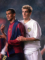 Rivaldo (Barcelona) and Jonathan Woodgate (Leeds). Leeds United v Barcelona. European Champions League, Group H, 24/10/00. Credit: Colorsport / Andrew Cowie.
