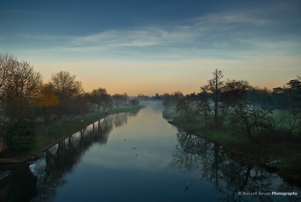 View of the River Avon at dusk from the Banbury Road Bridge, Warwick, Warwickshire, England, UK