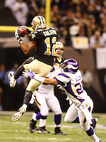 NEW ORLEANS - JANUARY 24: Marques Colston #12  of the New Orleans Saints catches pass against Asher Allen #21 of the Minnesota Vikings at the NFC Championship Game at the Louisiana Superdome on January 24, 2010 in New Orleans, Louisiana. The Saints won 31-28 in overtime to advance to the Super Bowl for the first time. Photo by Tom Hauck.