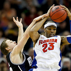 Mar 26, 2011; New Orleans, LA;  Florida Gators forward Alex Tyus (23) rebounds over Butler Bulldogs guard Chase Stigall (33) in the semifinals of the southeast regional of the 2011 NCAA men's basketball tournament at New Orleans Arena. Butler defeated Florida 74-71.  Mandatory Credit: Derick E. Hingle