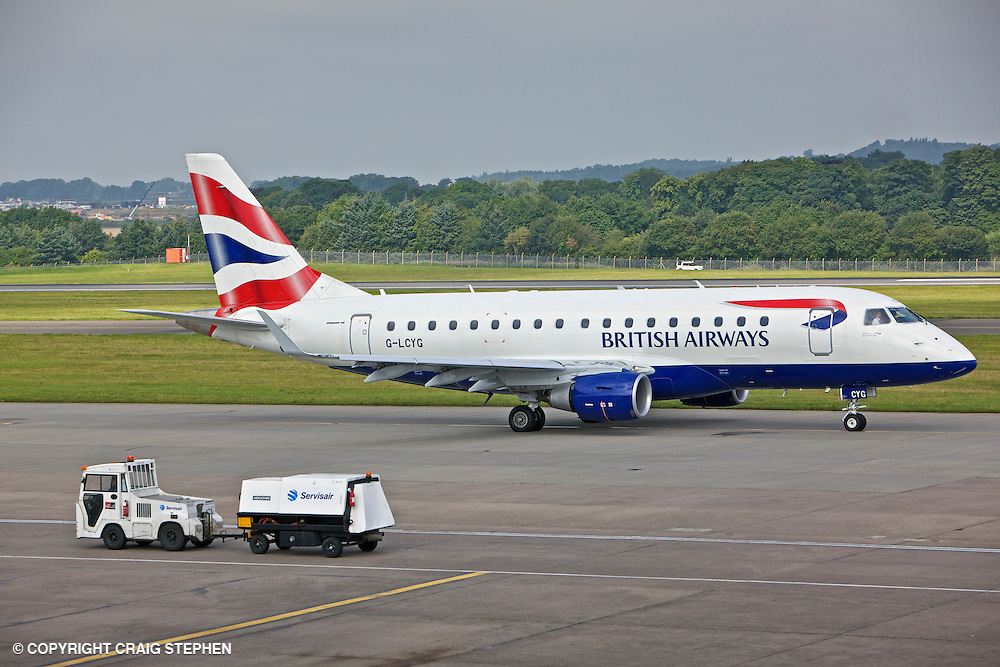 BA Cityflyer G-LCYG Embraer E170 STD at Edinburgh Airport with ancillary vehicle to fore