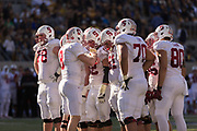 BERKELEY, CA -  NOVEMBER 22:  Quarterback Kevin Hogan #8 calls a play in the huddle with his Stanford Cardinal teammates during a PAC-12 NCAA football game against the California Golden Bears in the 117th Big Game played on November 22, 2014 at Memorial Stadium on the University of California campus in Berkeley, California.   Visible players include Kyle Murphy #78, Graham Shuler #52, Joshua Garnet #51, and Eric Cotton #80.   (Photo by David Madison/Getty Images) *** Local Caption ***