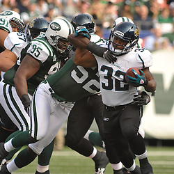 Nov 15, 2009; East Rutherford, NJ, USA; New York Jets linebacker David Harris (52) wraps up Jacksonville Jaguars running back Maurice Jones-Drew (32) during first half NFL action between the New York Jets and Jacksonville Jaguars at Giants Stadium.