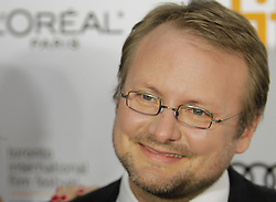 Director Rian Johnson with partner attending the 'Looper' opening night gala premiere at Roy Thompson Hall during the 2012 Toronto International Film Festival, Thursday September 6, 2012. Photo By Christopher Drost/i-Images