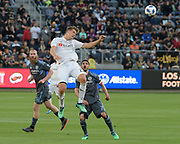 Los Angeles FC defender Walker Zimmerman (25) heads the ball against New York City during a MLS soccer match in Los Angeles, Sunday, May 13, 2018. The game ended in a 2-2 tie. (Ed Ruvalcaba/Image of Sport)