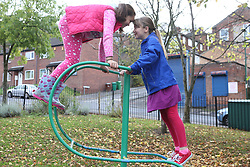 Girls playing in urban park
